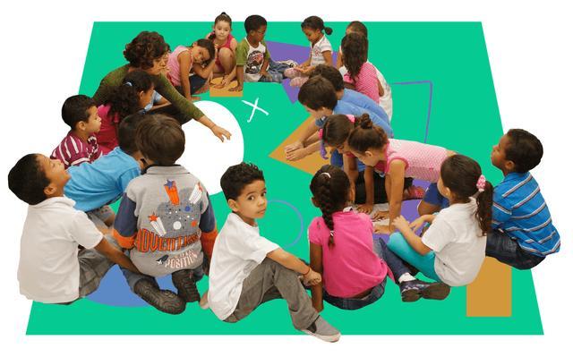 roda de crianças sentadas no chão junto com professora